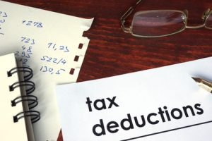 Tax deductions written on a paper.